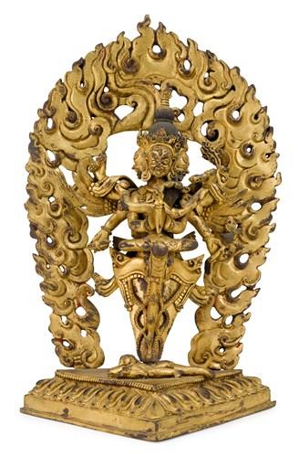 Lot 88 - Sino-Tibetan gilt bronze tantric grouping