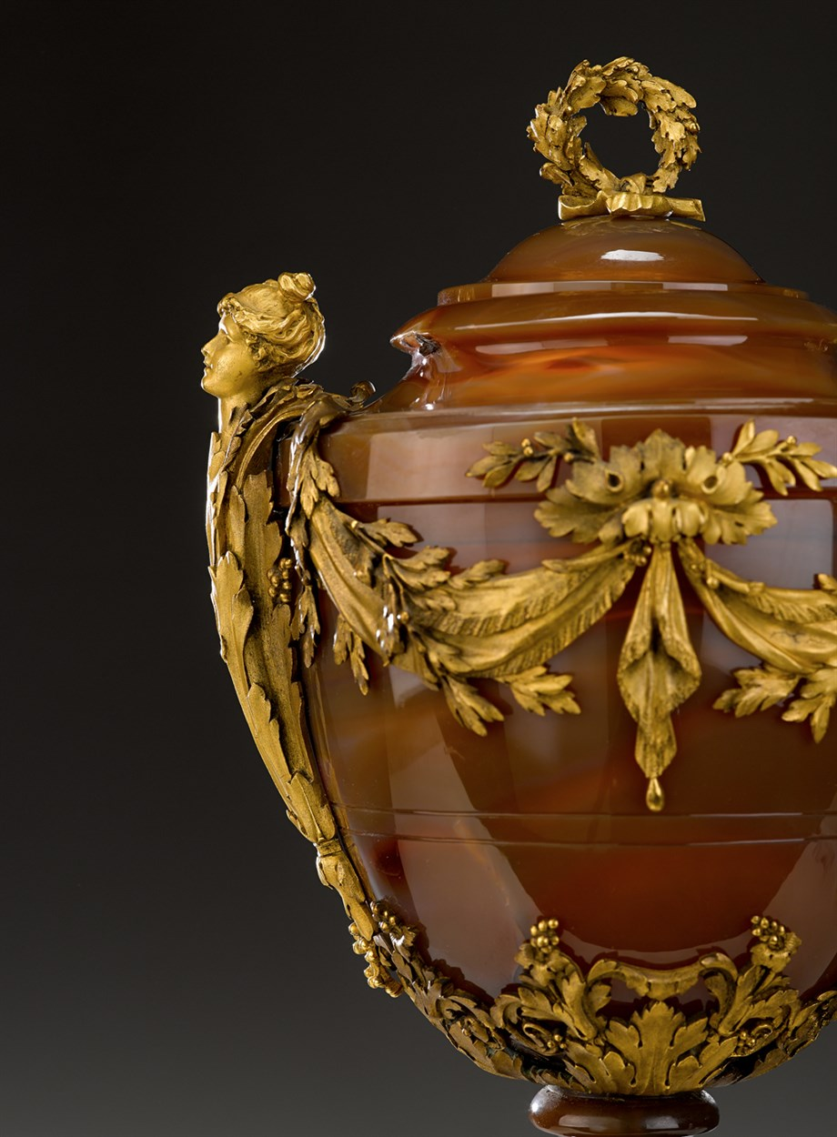 Lot 321 - An exceptional pair of Louis XVI style gilt bronze mounted agate and bloodstone covered urns