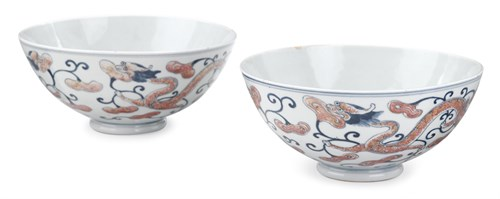 Lot 61 - Pair of Chinese copper-red decorated blue and white porcelain dragon bowls