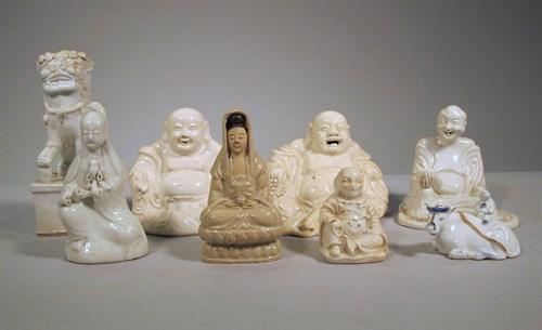 Lot 52 - Eight Chinese blanc de chine porcelain figures