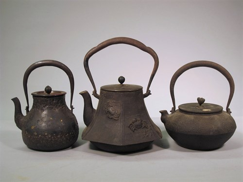 Lot 73 - Three Japanese iron tetstubin