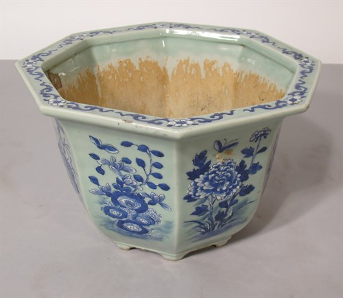 Lot 53 - Chinese blue and white slip decorated planter