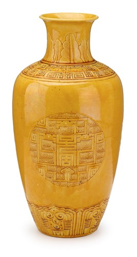 Lot 55 - Chinese incised yellow glazed porcelain vase