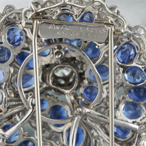 """Lot 147 - A sapphire and diamond """"Camellia"""" brooch, Van Cleef and Arpels"""
