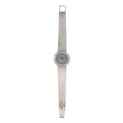Lot 61 - Patek Philippe. Eighteen karat white gold and diamond bracelet watch