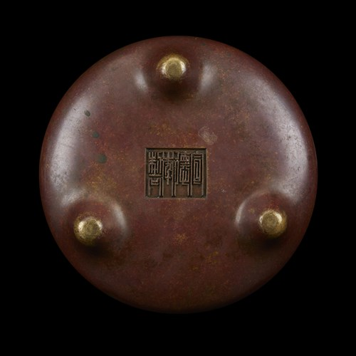 Lot 531 - A Chinese patinated bronze tripod censer and foliate stand