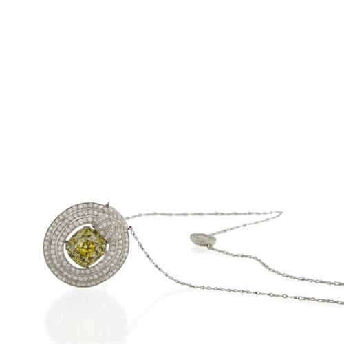 Lot 172 - A rare Belle Époque fancy vivid yellow diamond pendant, J.E. Caldwell and Co.
