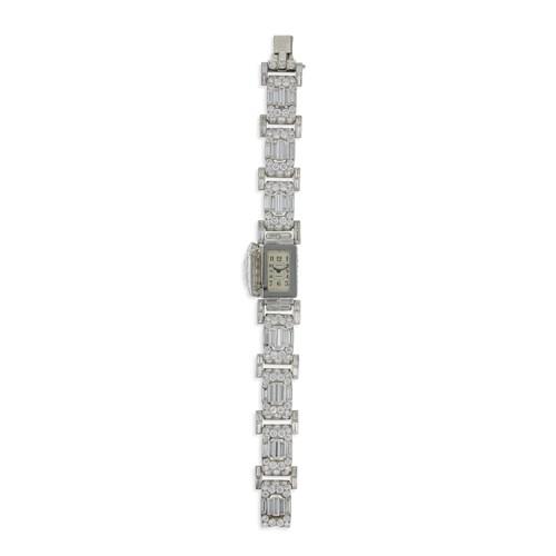 Lot 1014 - An Art Deco diamond covered bracelet-watch