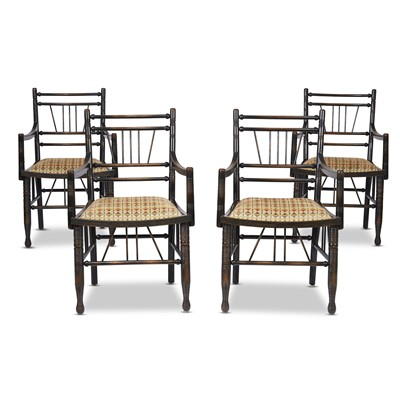 Lot 97 - A set of four Arts & Crafts style ebonized 'Thebes' armchairs