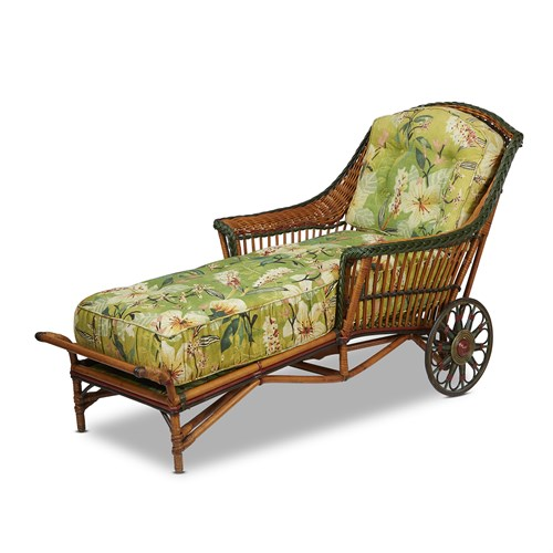 Lot 72 - A polychrome painted rattan and upholstered chaise longue