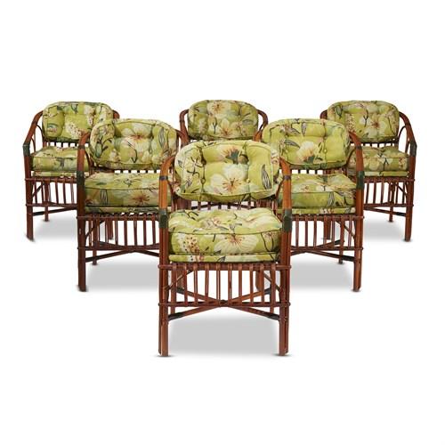 Lot 73 - A set of six upholstered rattan horseshoe back armchairs