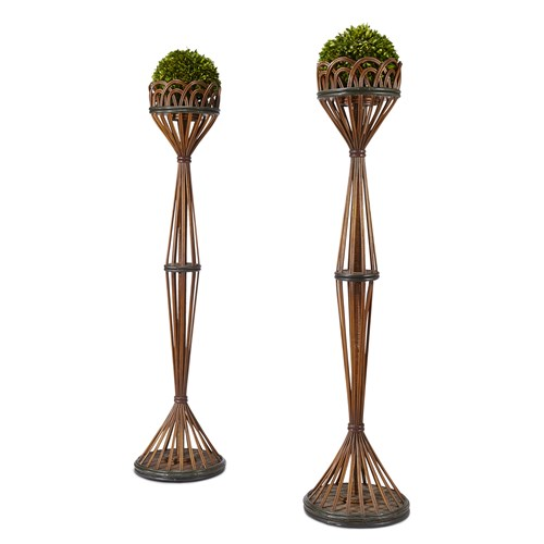 Lot 71 - A pair of tall polychrome painted rattan plant stands